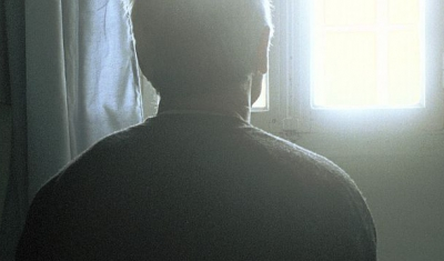 Picture of the back of a man staring at the window