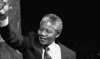 Nelson Mandela, Deputy President of the African National Congress of South Africa, raises his fist in the air while addressing the Special Committee Against Apartheid in the General Assembly Hall. 22 June 1990