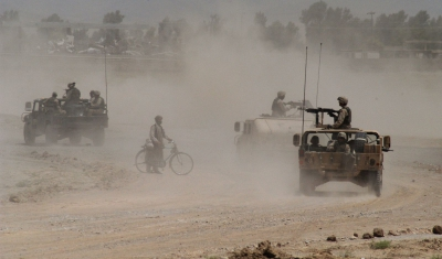 Afghanistan, Khandahar. After a road bomb destroyed a US Army vehicle, troops are patrolling the area to look for clues.