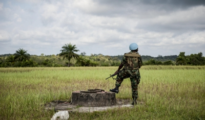 A Ghanaian peacekeeper with the UN Mission in Liberia (UNMIL) is pictured on guard duty during a visit by Karin Landgren, Special Representative of the Secretary-General and Head of UNMIL, in Cestos City, Liberia.