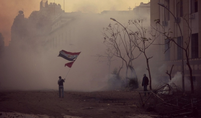 Egypt, Cairo. A protester standing in Mansour Street near to the junction of Mohammed Mahmoud Street