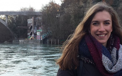 Annabelle Gagnon, LLM student at the Geneva Academy, in front of the Pointe de la Jonction in Geneva