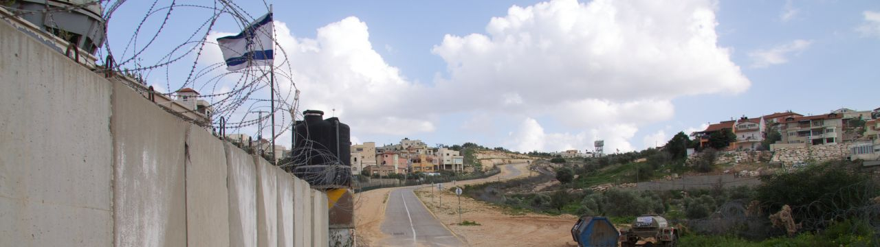 West Bank, Qalqilya, enclaved village of Azun Atme. Azun Atme check-point and West Bank barrier between Beit Amin and the settlement of Sha'arei Tikva