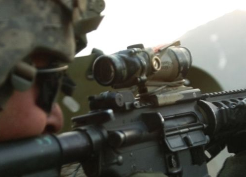 A U.S. Army Soldier with 1st Battalion, 32nd Infantry Regiment, 10th Mountain Division, fires an M-4 rifle during a gun battle with insurgent forces in Barge Matal, during Operation Mountain Fire, July 12.