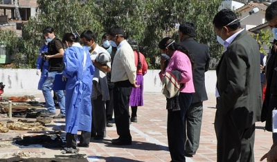 Peru, Ayacucho, Forensic Institut. With the help of the prosecutor's office staff, families try to identify the clothes of their missing relatives.